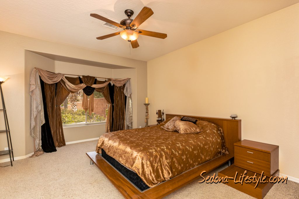 Large Master bedroom Sedona Golf Resort home offered by Sheri Sperry
