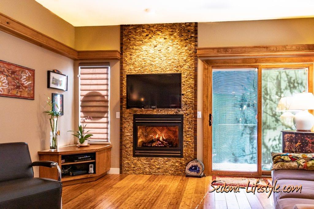 Gas Fireplace Stacked Brick 1406 Vista Montana - Sheri Sperry SellSedona.com Coldwell BankerFeature Wall